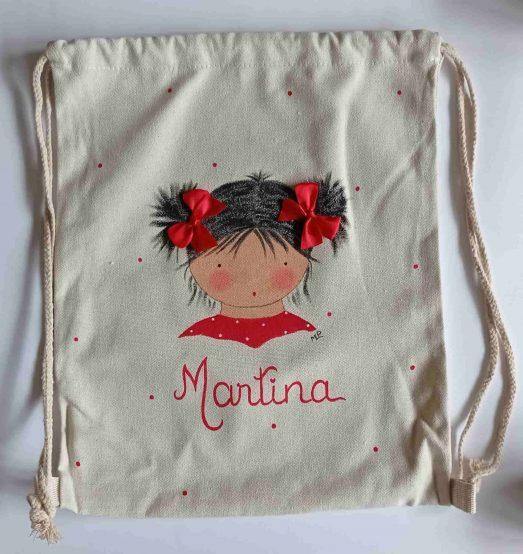mochila saco infantil de tela rojo con colitas y pelo corto sin relleno